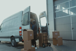 man loading delivery van with boxes